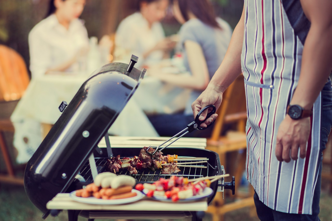 Asian-men-are-cooking-for-a-group-of-friends-to-eat-barbecue-1