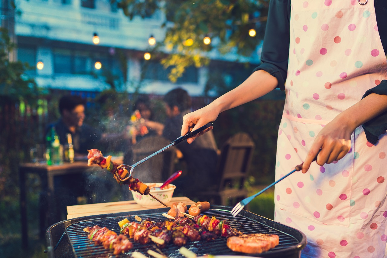 Asian-woman-are-cooking-for-a-group-of-friends-to-eat-barbecue