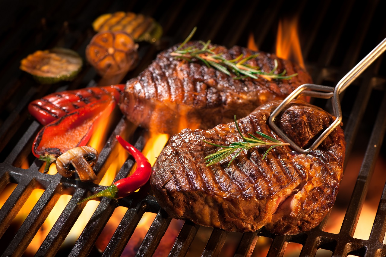 Beef-steaks-on-the-grill-with-flames