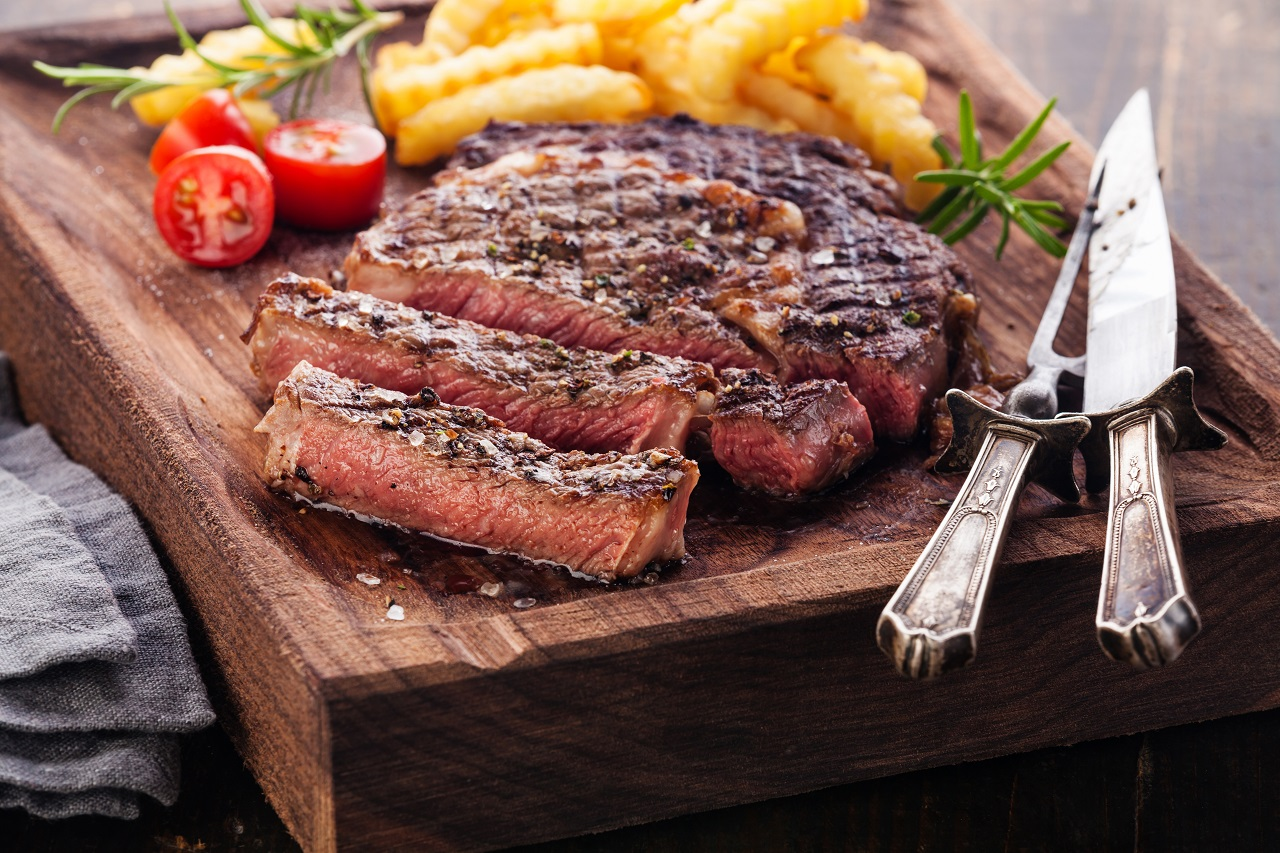Sliced-medium-rare-grilled-Steak-Ribeye-with-french-fries
