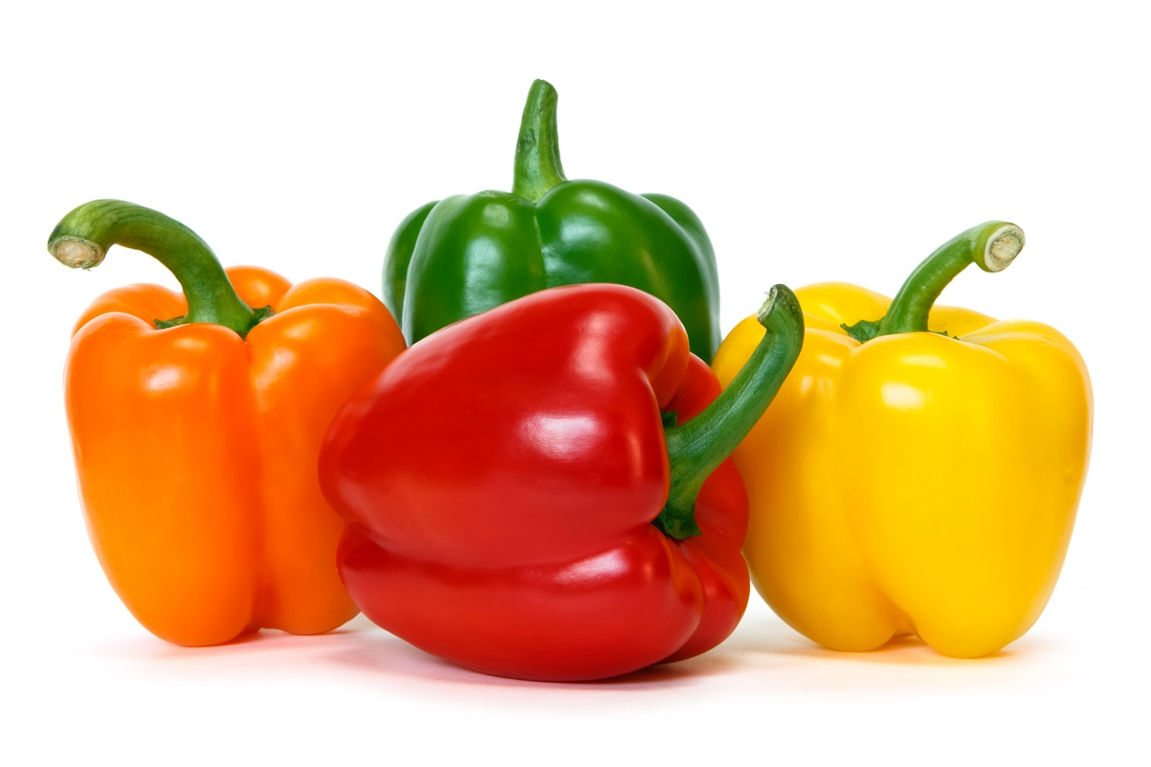 colored-peppers-over-white-background