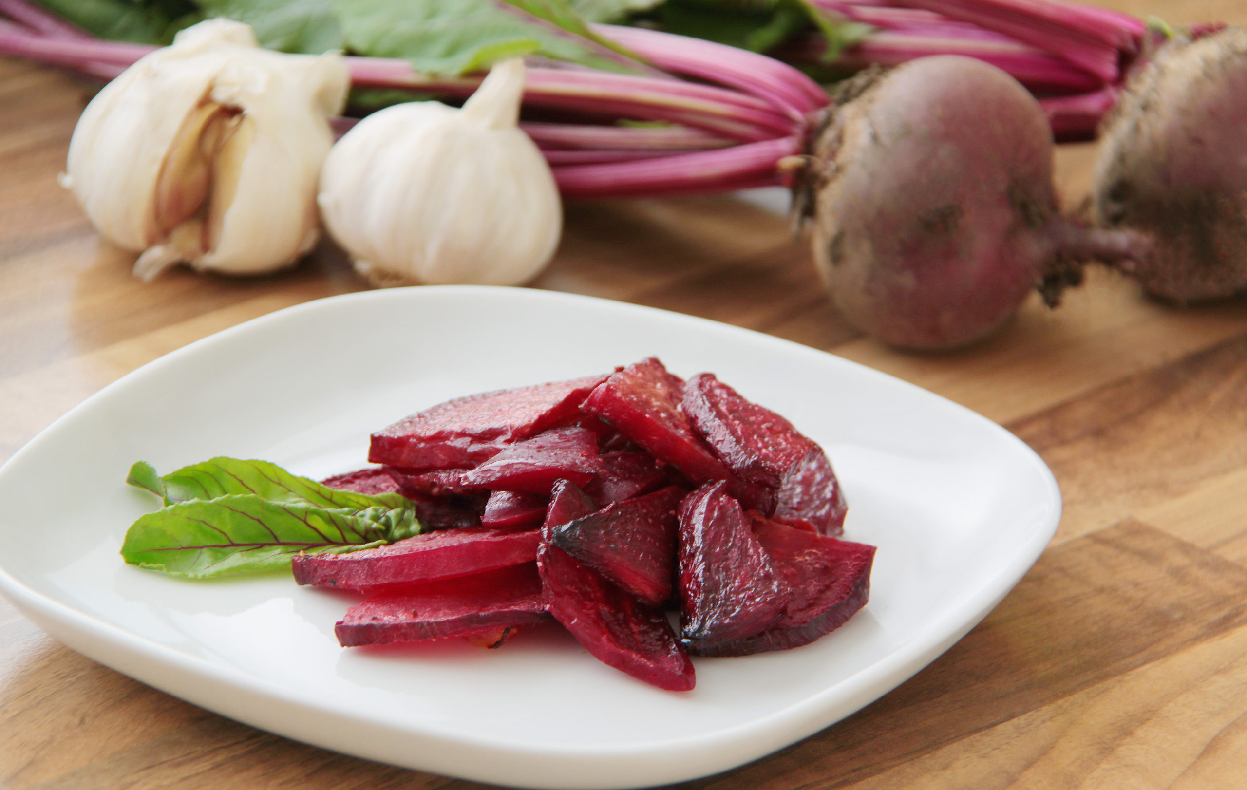 Roasted-slices-of-beetroot-served-on-a-white-plate-scaled